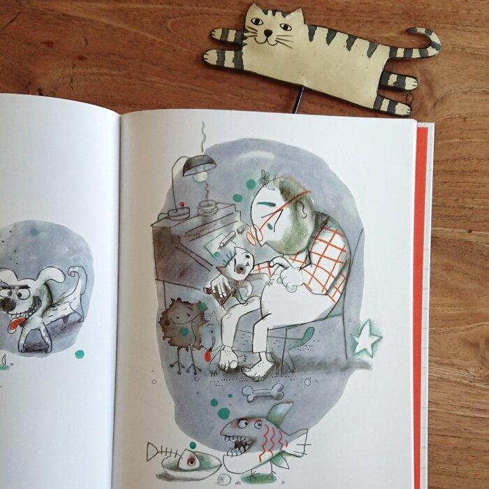 Innenseite aus dem Bilderbuch: der Schriftsteller spricht mit seiner Katze